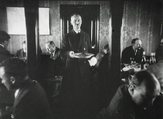 Heinrich Kubis serving a meal aboard LZ-127