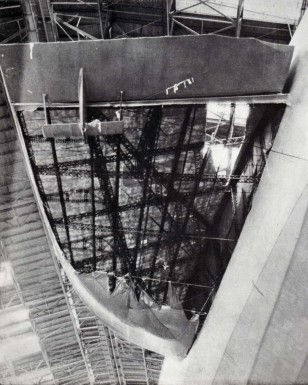 The damaged port fin after arrival at Lakehurst (view from floor of hangar)