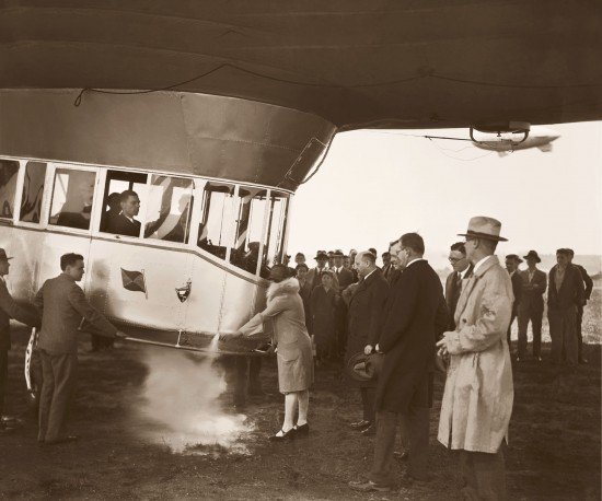Mrs. Karl Arnstein christening Mayflower with a flask of liquefied air, May 21, 1929